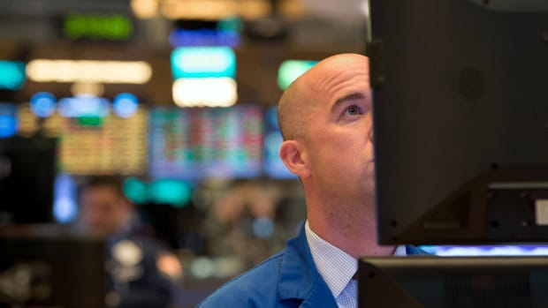 Dow Ends Lower as Stocks Slide on Slowing Growth