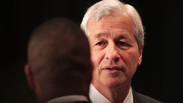 JPMorgan Shares Gain as Rate Hopes Offset Downgrade