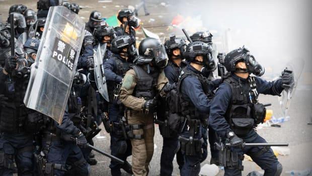 Hong Kong Tumbles Into Recession Amid Protests, Trade Tensions
