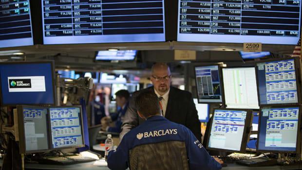 Market Hustle: Stock Futures Sink as JPMorgan's Profit Shrinks