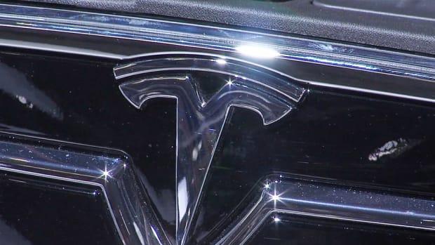 Tesla Shares Slide Despite Earnings Beat, Expansion Into China