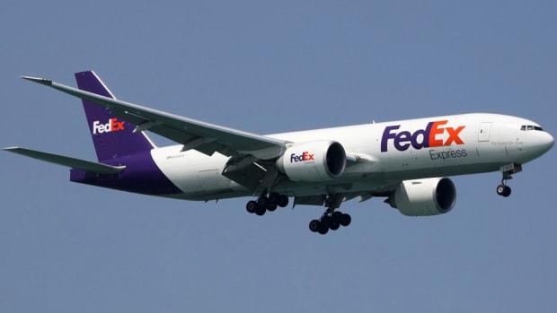 FedEx Pops on TNT Bid; Stocks Gain as Job Openings Hit 14-yr High