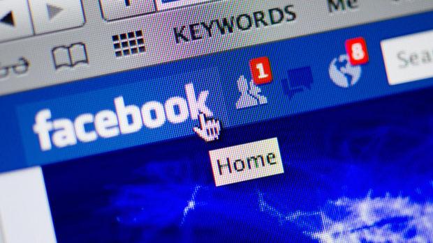 Facebook Pushes Nasdaq to Gains, Dow Closes Down Triple Digits