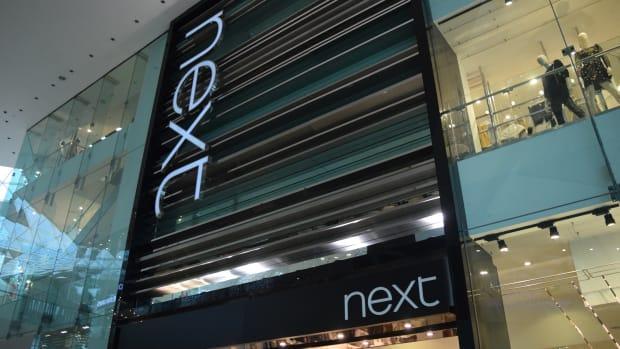 Next Stock Plummets on Profit Warning as British Retailers Struggle