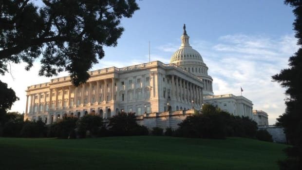 Stocks Sink Ahead of Tax Bill Vote