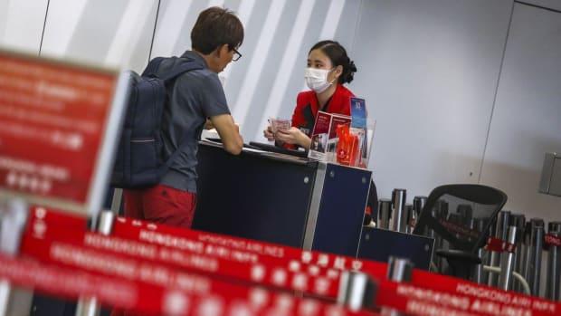 Hong Kong Airlines staff at a check-in counter at Hong Kong International Airport. Photo: Nora Tam