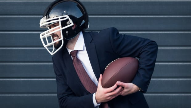 Man Suit Football Lead