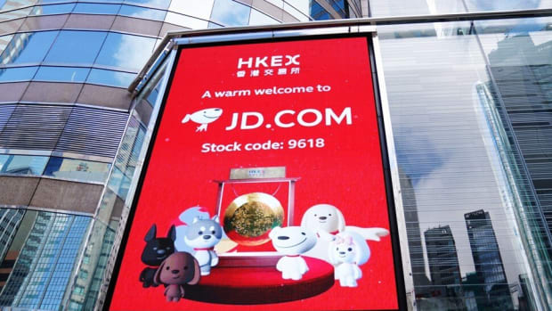 JD.com sign celebrates the e-commerce giant's secondary listing in Hong Kong. Photo: Xinhua