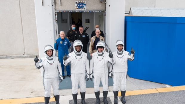Photo by NASA/Joel Kowsk. NASA astronauts Shannon Walker, left, Victor Glover, and Mike Hopkins, and Japan Aerospace Exploration Agency (JAXA) astronaut Soichi Noguchi, right, wearing SpaceX spacesuits, stop to pose for a picture.