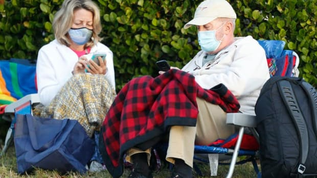 Seniors in Fort Myers, Fla. wait for their COVID-19 vaccinations. At this site, 800 doses of vaccine were available.