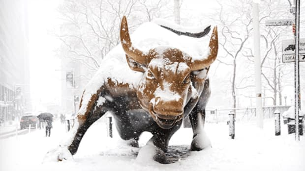 Charging bull in snow Wall Street