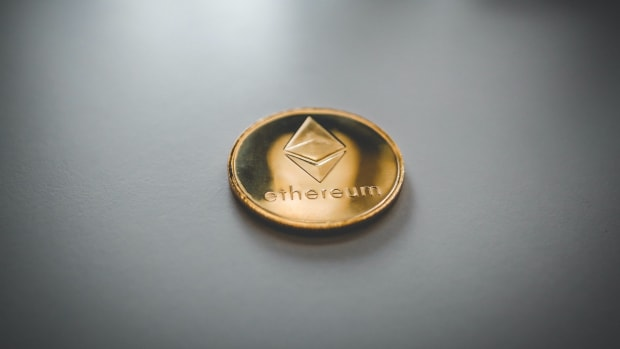Gold coin with Ethereum logo.