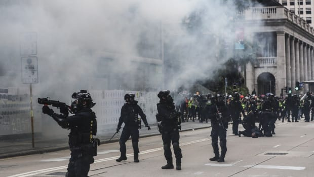 Tear gas and riot police have been a regular sight in Central and other parts of Hong Kong, which has had a devastating impact on city tourism. Photo: Sam Tsang