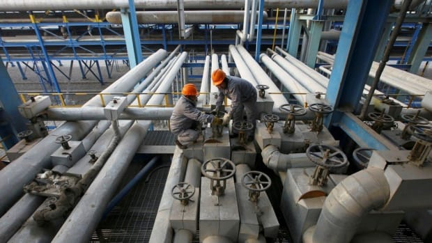 Employees closing a valve at a PetroChina refinery in Lanzhou in Gansu province on January 7, 2011. Photo: Reuters