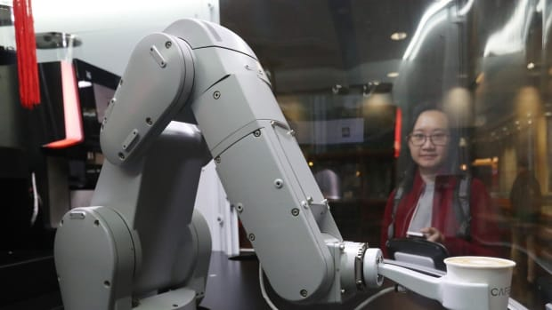 RPA software is different from hardware robots, such as robotic arms that can serve drinks at a bar. Photo: SCMP/Nora Tam