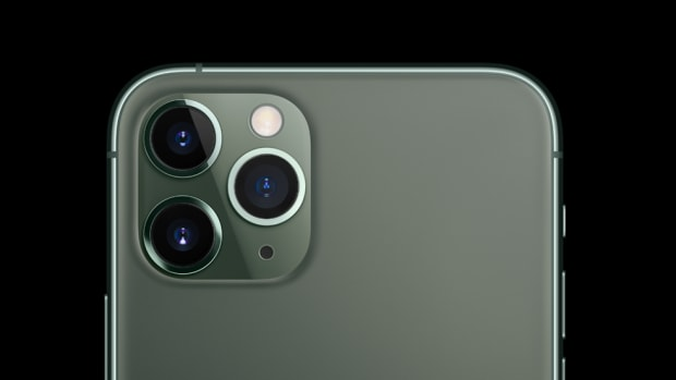 Close up of Apple iPhone 11, black and neutral background