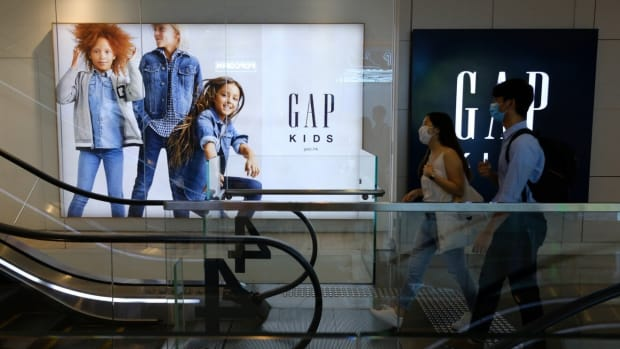 People go past an advertisement outside the Gap store in Hysan Place, Causeway Bay. Photo: Martin Chan