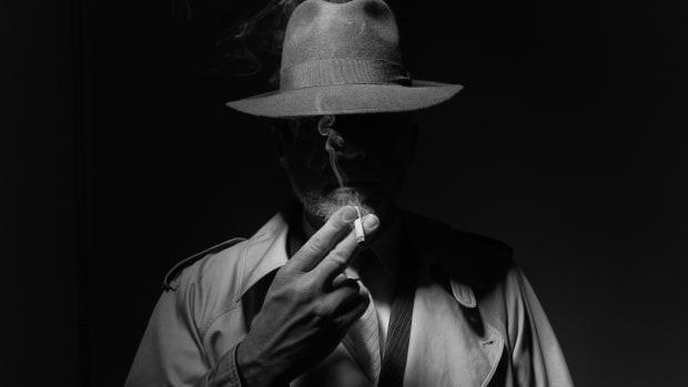 undercover car sales smoke cigarette hat sh