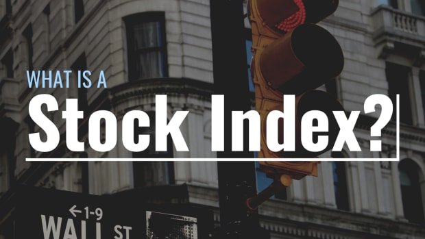 """Darkened photo of the intersection of Wall Street and Broadway in New York with text overlay that reads """"What Is a Stock Index?"""""""