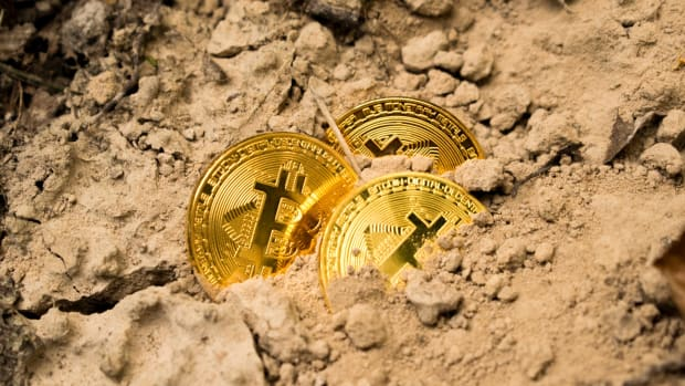 Three Bitcoins buried in soil.