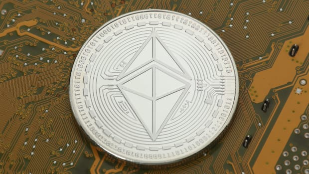 Ethereum coin on circuit board.