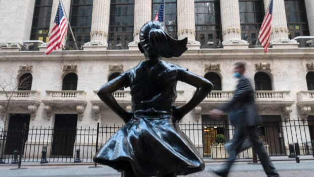 People walk past the New York Stock Exchange on Wall Street. The benchmark S&P 500 Index rose to an all-time high on Wednesday. Photo: AFP