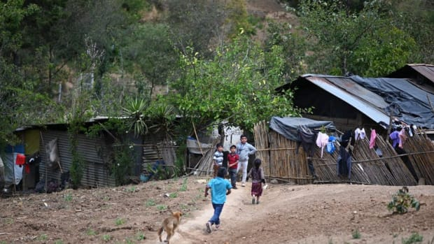 Children play in Las Flores village, Comitancillo, Guatemala, home of a 22-year-old migrant murdered in January 2021 on his journey through Mexico.
