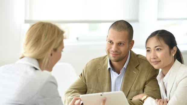 couple adviser meeting sh