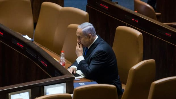 Benjamin Netanyahu sits in the Knesset before parliament voted June 13, 2021, in Jerusalem to approve the new government that doesn't include him, Amir Levy/Getty Images