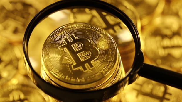 videoblocks-bitcoins-under-magnifying-glass-blockchain-technology-bitcoin-mining-concept-crypto-currency-gold-bitcoin-btc-bitcoins-and-loupe_hwg6v31ehm_1080__D