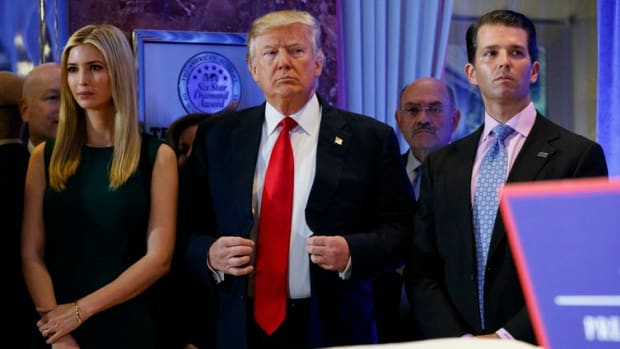The Trump Organization is run by Trump's children and loyalists like Allen Weisselberg, seen here in the background. AP Photo/Evan Vucci