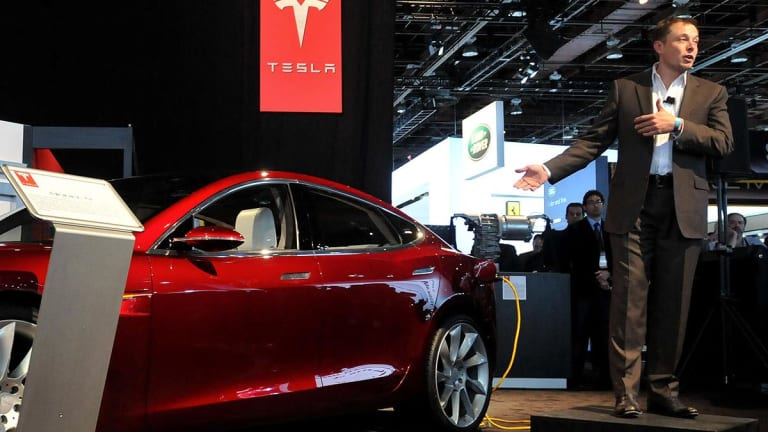 Tesla Extends Declines as $35,000 Model 3 Unveiling Raises Q1 Profit Questions