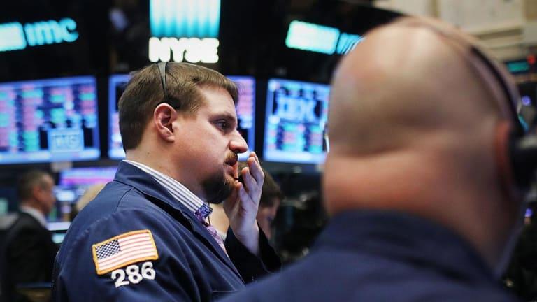 Global Stocks Drift Lower Ahead of U.S. GDP Data; Dollar Tests Two-Year High