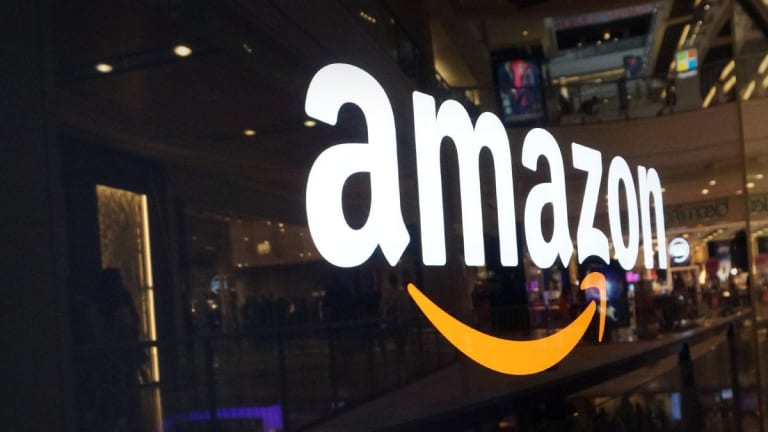 Amazon, Visa and Caterpillar Report Earnings Next Week - Here's What to Expect