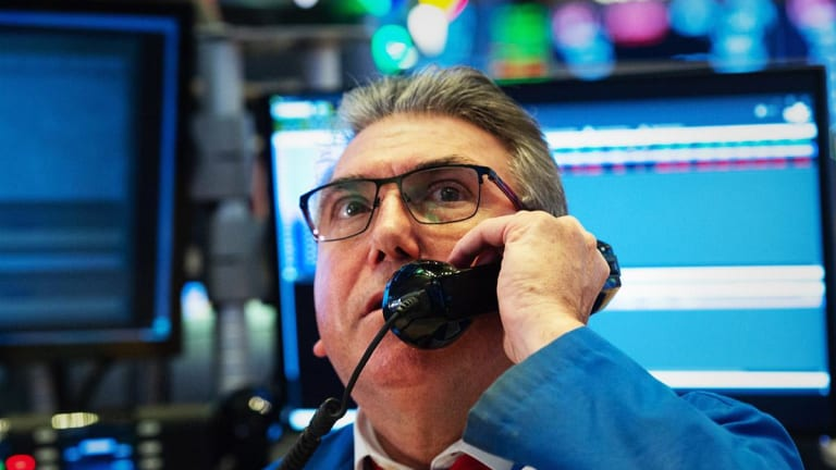 Dow Ends Slightly Higher Despite Slowing Global Growth Worries