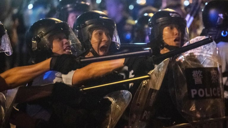 Hong Kong Protests Intensify as Officers Fire Tear Gas Into Crowds