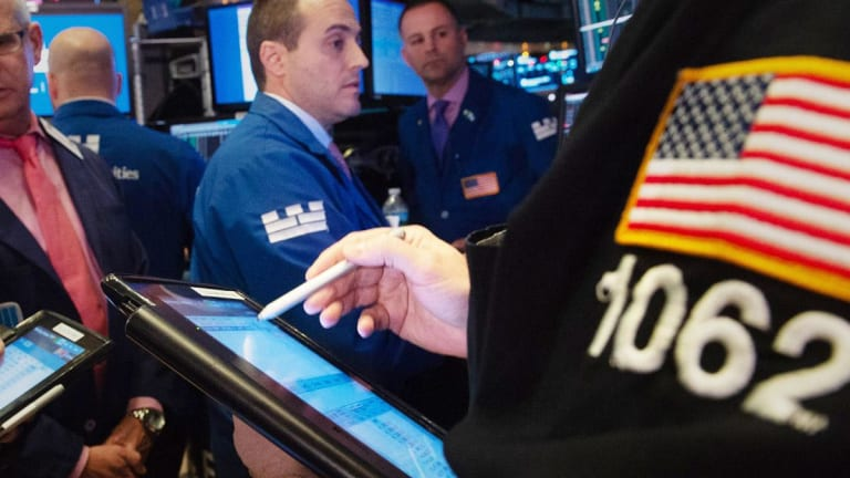 Dow Closes Higher as Wall Street Looks to Next Round of Trade Talks