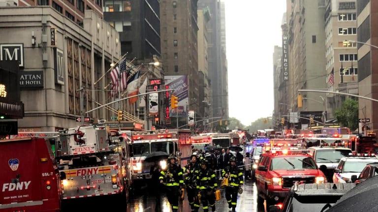 Helicopter Strikes Midtown Manhattan Financial Building, 1 Dead