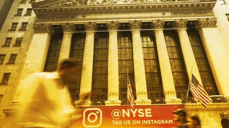 Dow Slips, Nasdaq Gains as Stocks End Mixed
