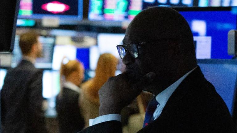 Nasdaq Closes at Record, Dow Flat as Trump Teases China Trade Pact, Slams Fed