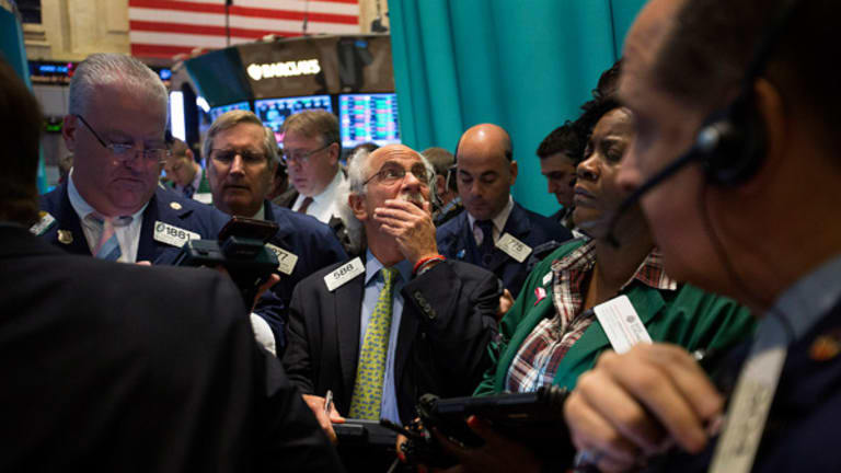 Stocks Slip from Record Highs as Investors Digest Fed Direction