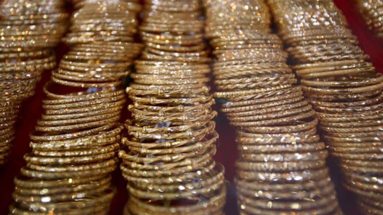 Gold Prices Slip on Greece Debt Deal, U.S. Data (Update 1)