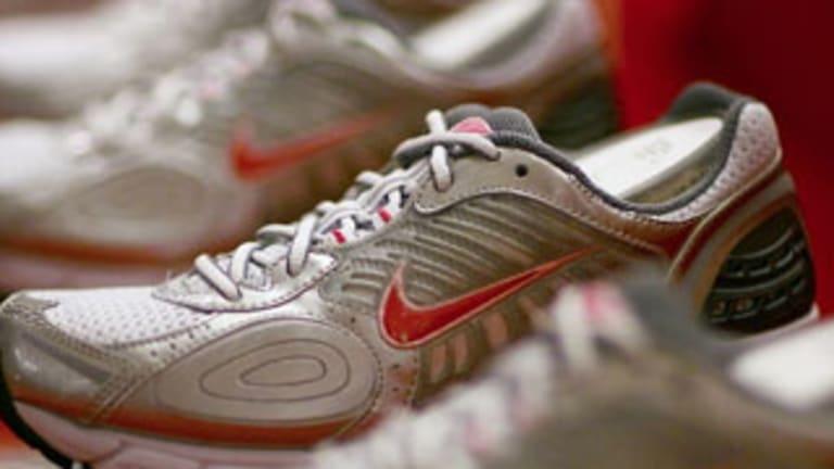 Nike Battles Upstart Under Armour, High Expenses