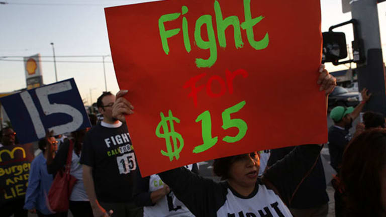 'Fight for 15' Protesters Gather Outside McDonald's Shareholders Meeting