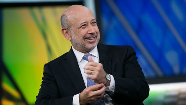 Wall Street Takes Pay Cut, but Bankers Don't Dare Complain