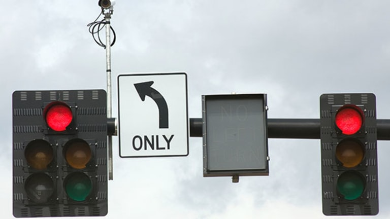 Do the Red Light Cameras Draining Your Wallet Make Roads Less Safe?