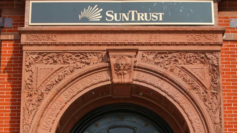 SunTrust Reports Big Drop in Expenses (Update 1)