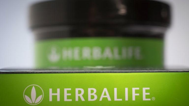 Herbalife Slips Despite Raising Guidance