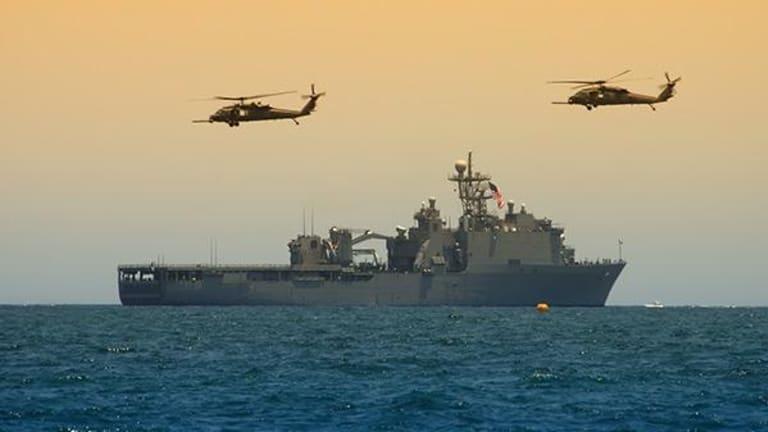 U.S. Navy Ship Fires Warning Shots at Iranian Vessel