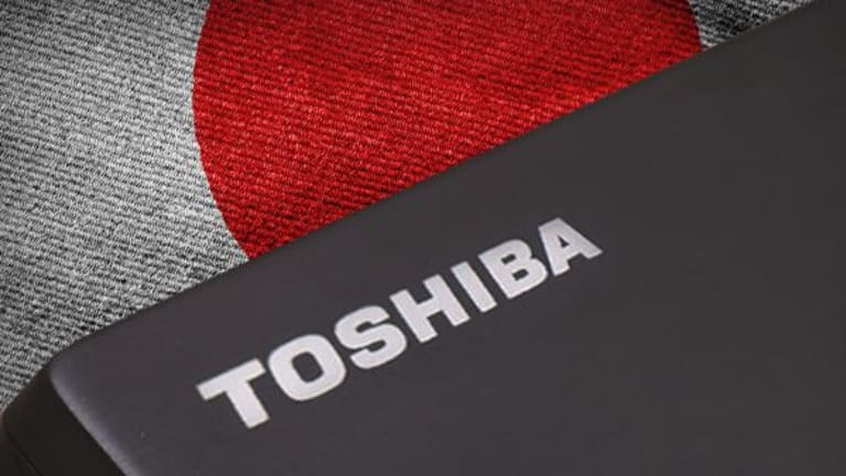 Toshiba Shares Dip as Investors Question Memory Unit Sale After Bain-led Group Wins Bidding War